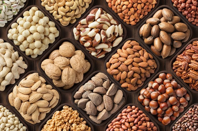 assorted nuts background, large mix seeds. raw food products: pe