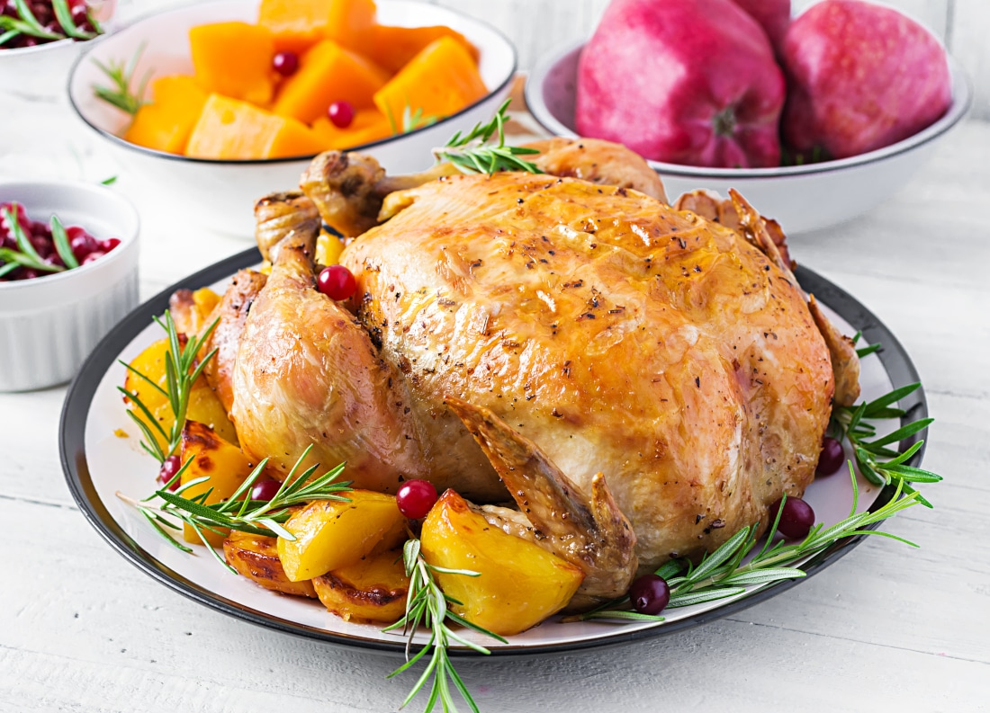 roasted-turkey-garnished-with-cranberries-on-rustic-style-table-decorated-autumn-leaf-thanksgiving-day-baked-chicken